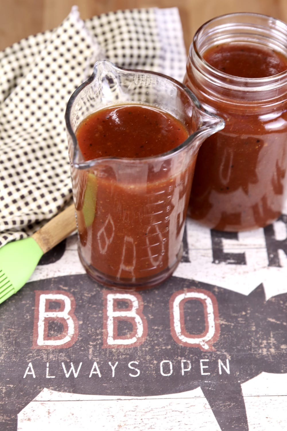 2 jars of bbq sauce on a tray