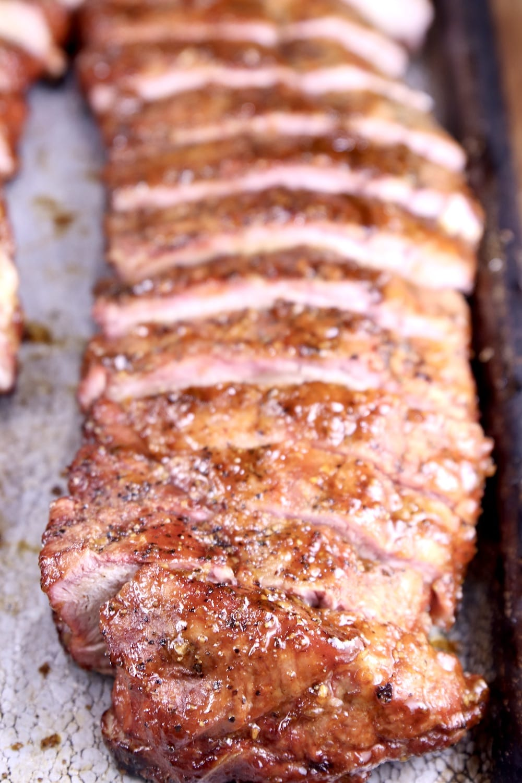 rack of sliced bbq ribs on a pan