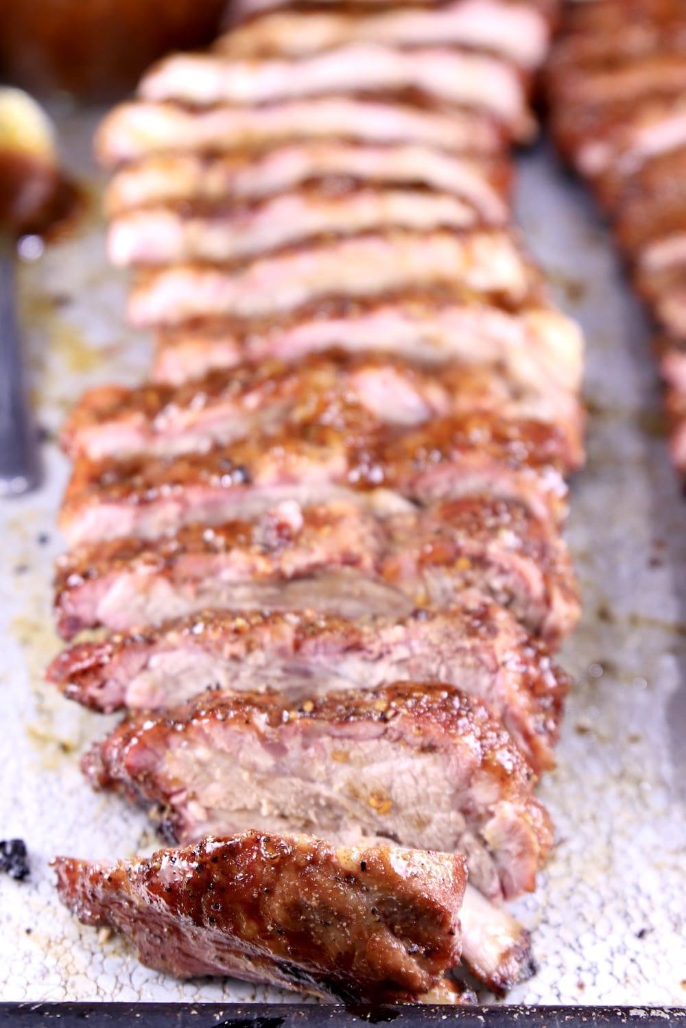 Peach BBQ Ribs sliced on a baking pan