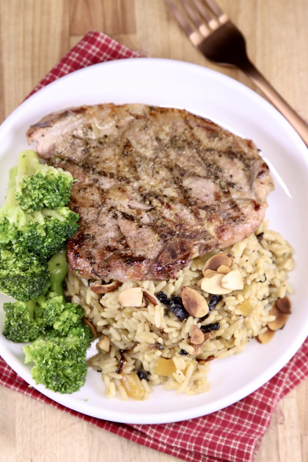 Plate with rice pilaf, broccoli and grilled pork chop