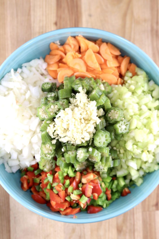 Blue bowl of chopped vegetables for gumbo