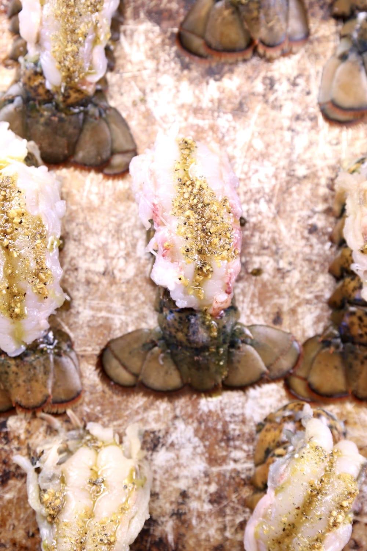 garlic butter brushed over lobster tails