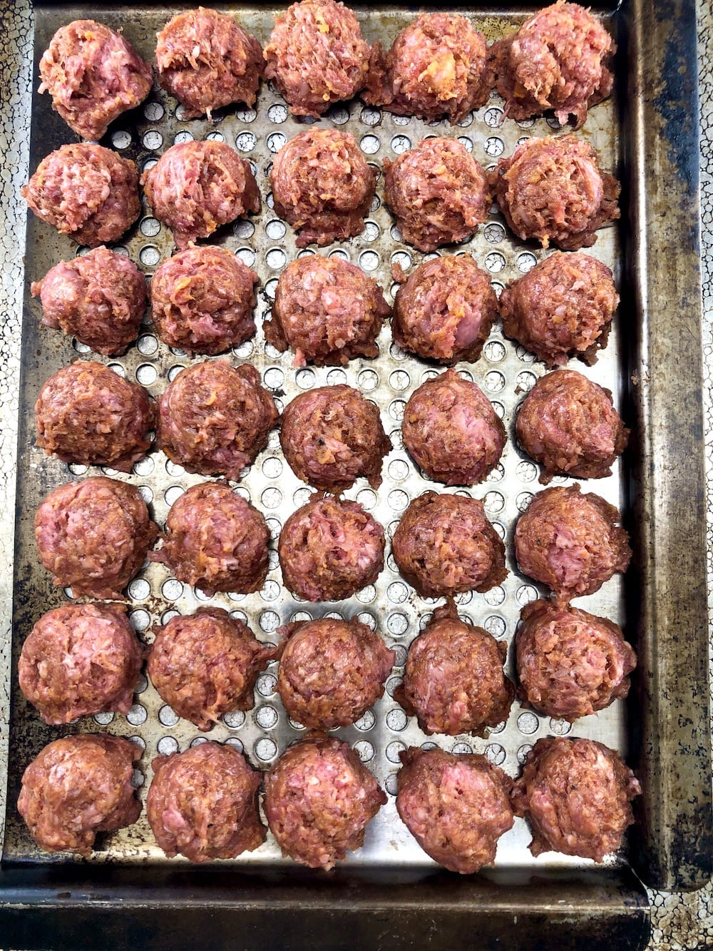 grill pan of meatballs