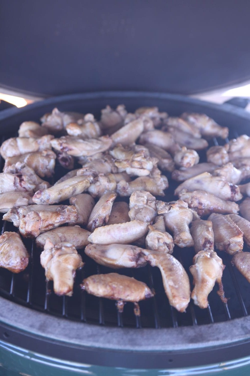 smoking chicken wings on a grill