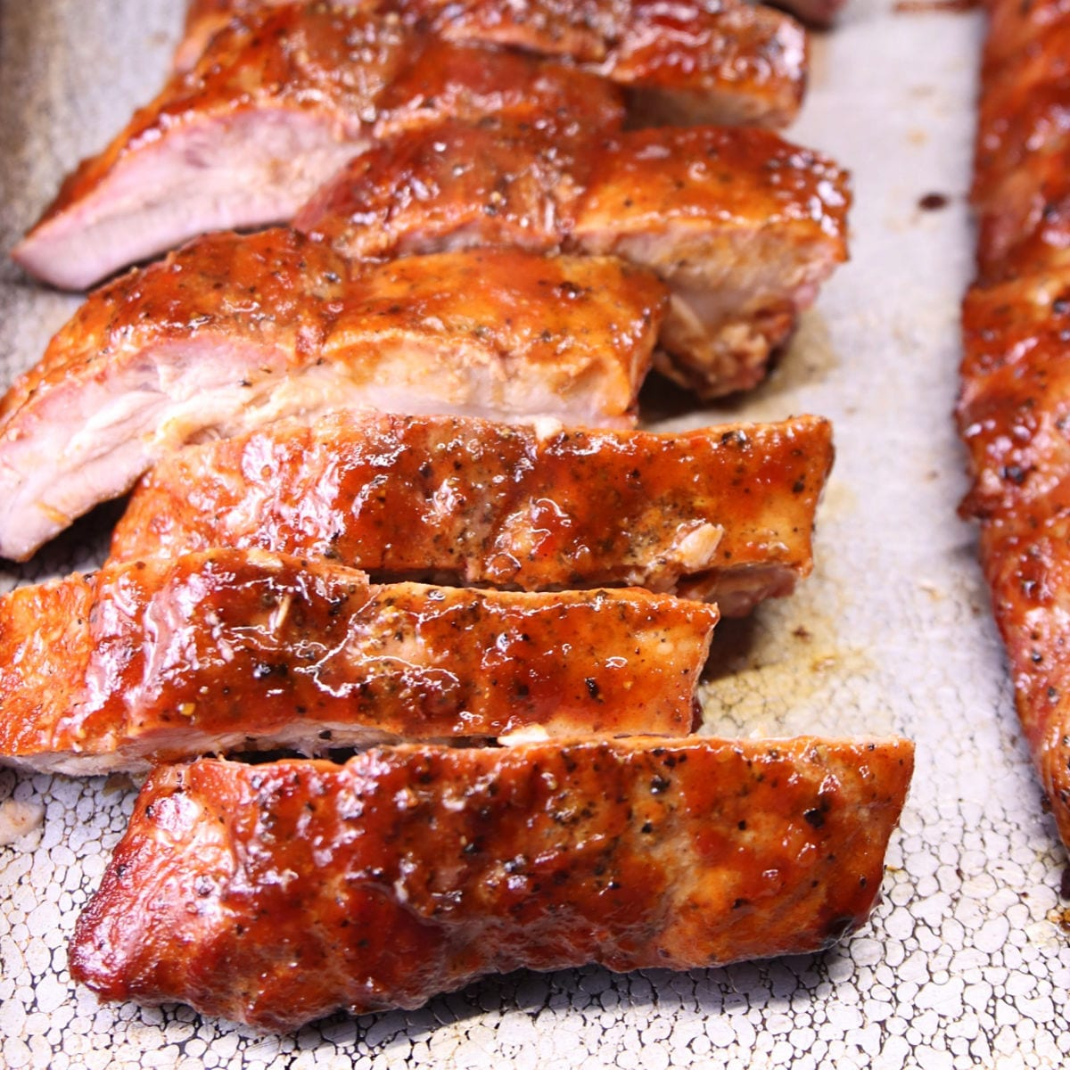 Maple BBQ Baby Back Ribs sliced on a baking sheet