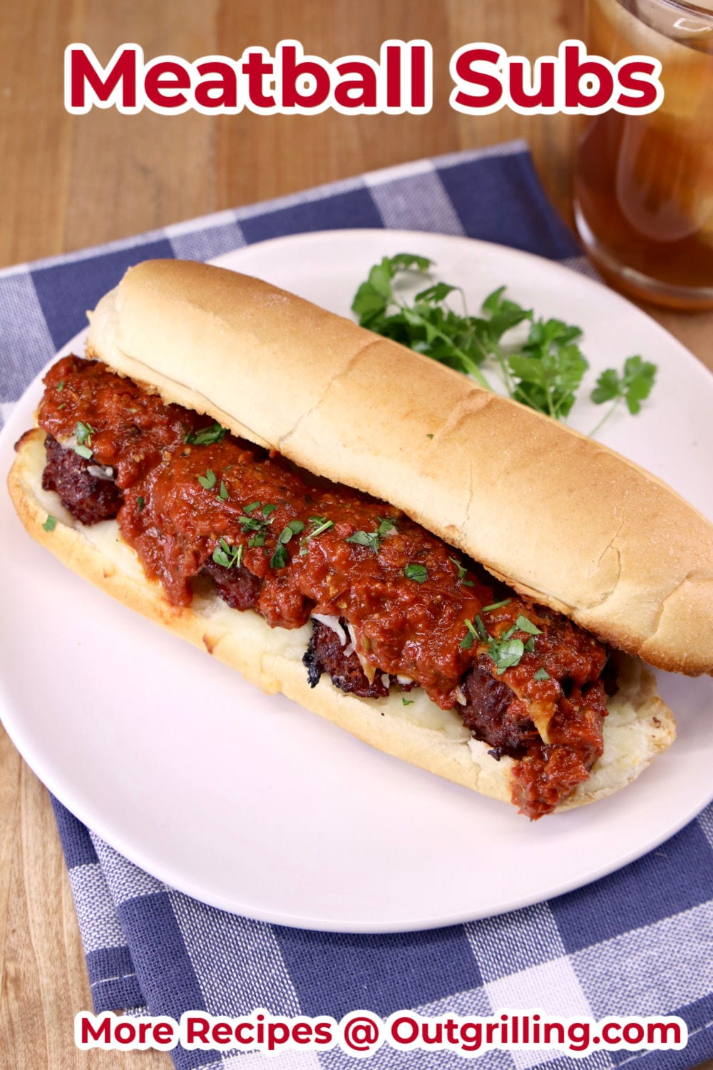 Meatball Marinara Sub Sandwich on a white plate with parsley garnish
