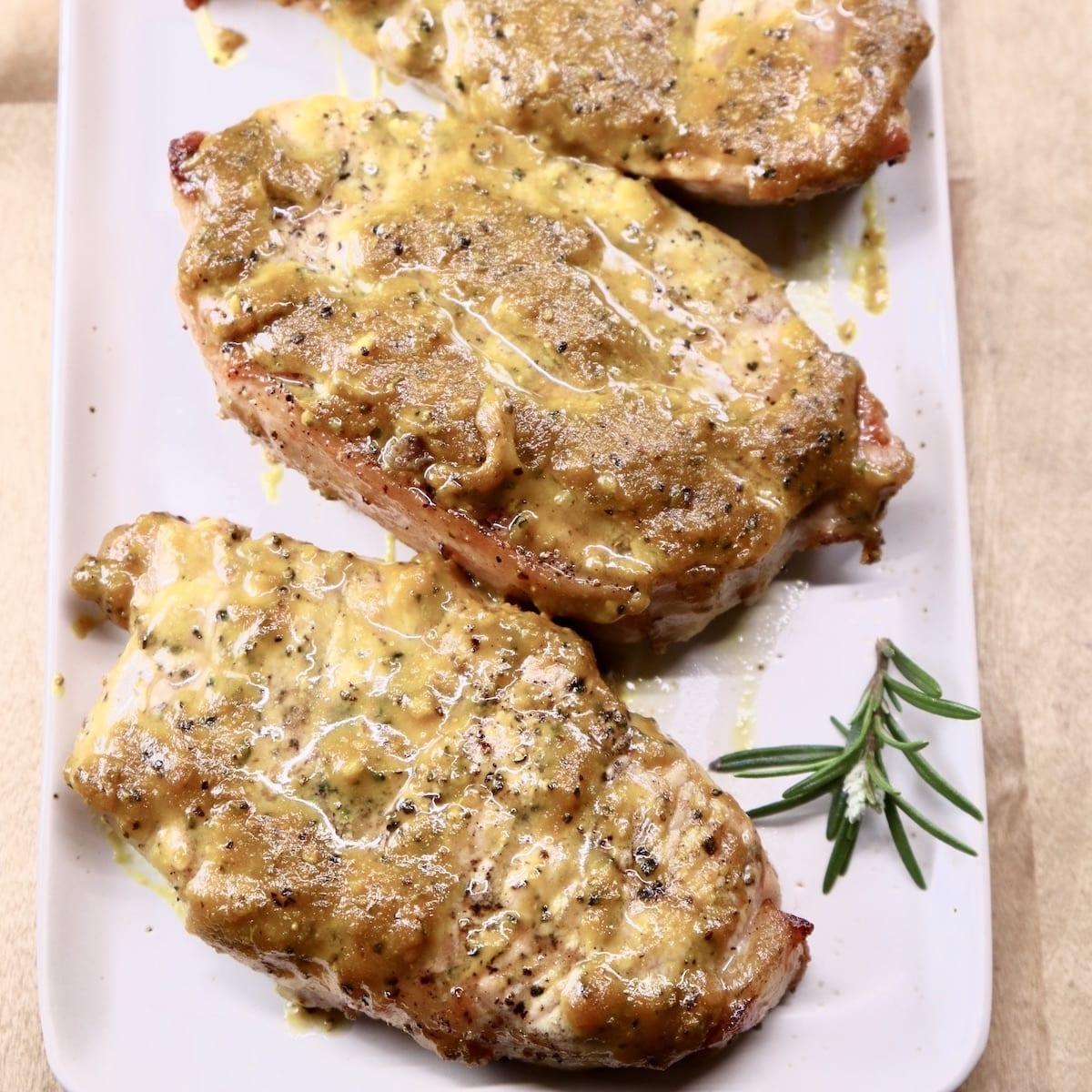 Rosemary Mustard BBQ Pork Chops on a platter