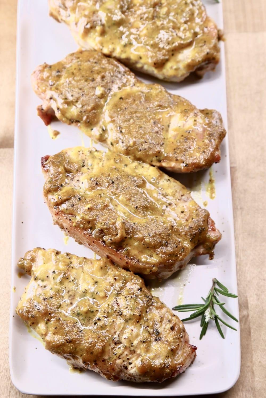 Rosemary Mustard Pork Chops on a platter