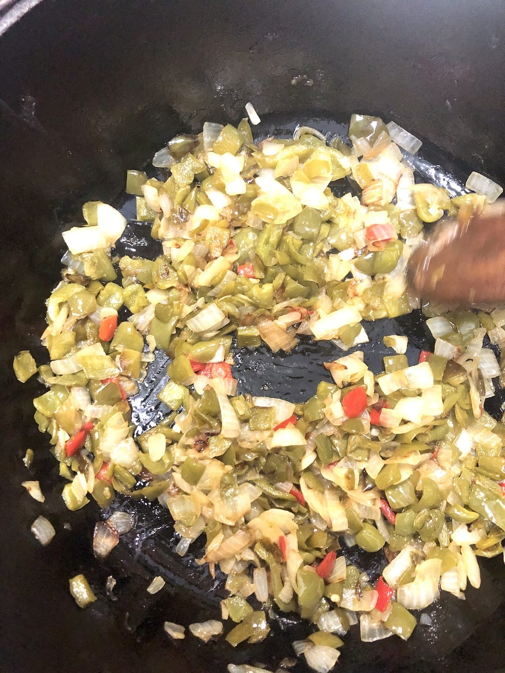 cooked onions and peppers in a dutch oven