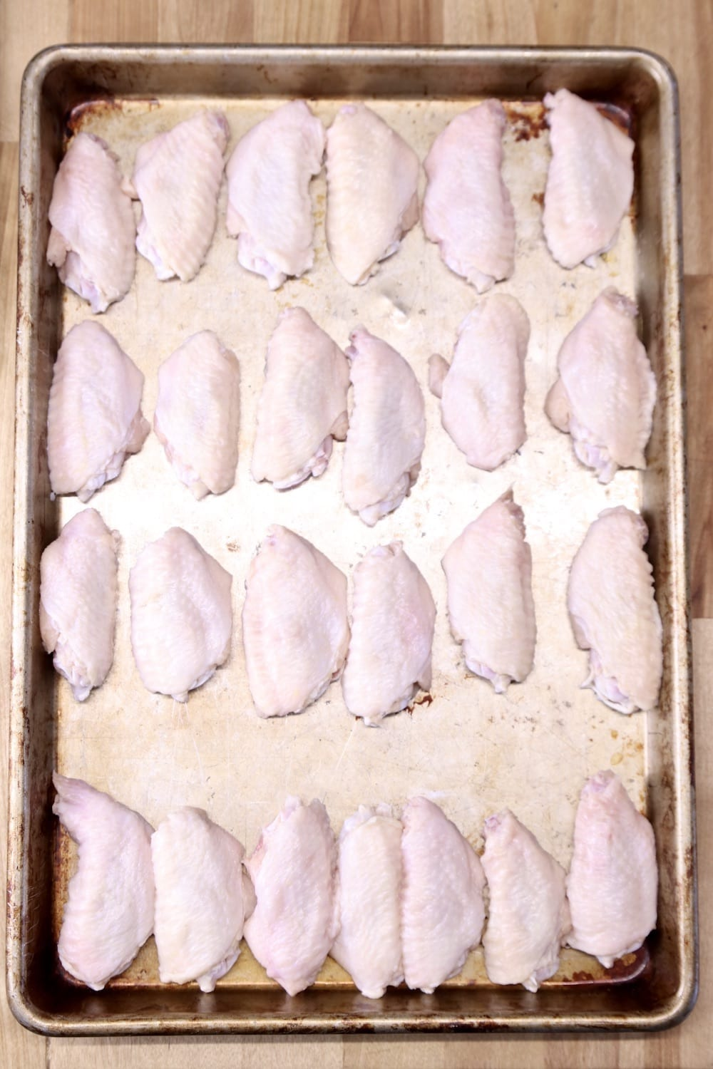 chicken wings on a baking sheet - uncooked