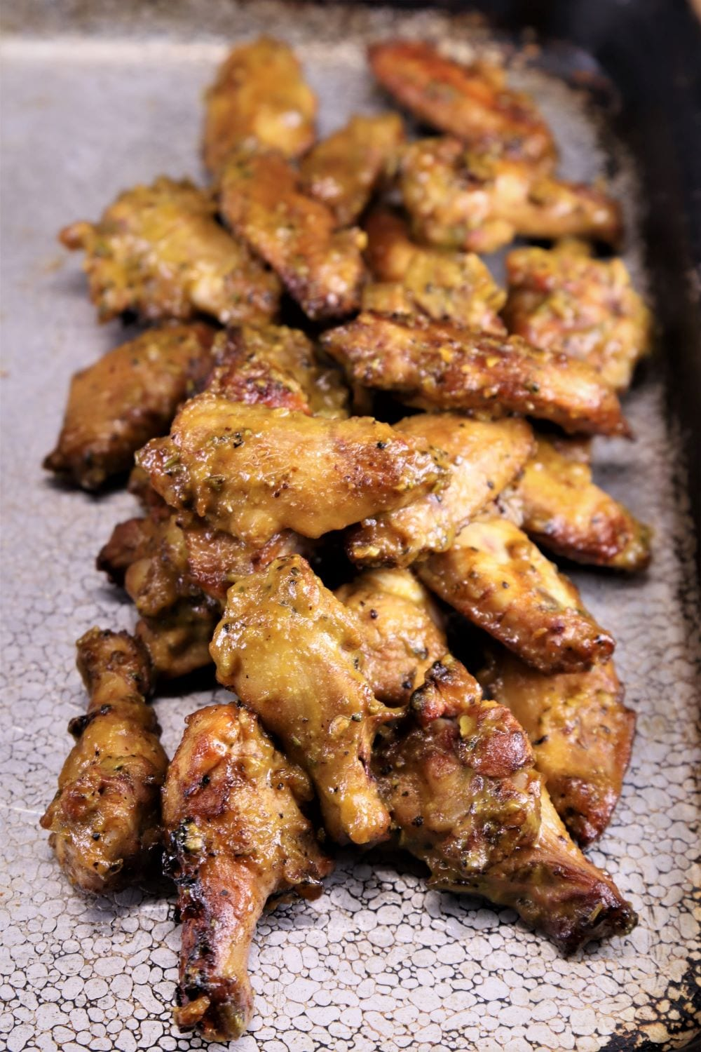 grilled chicken wings on a sheet pan
