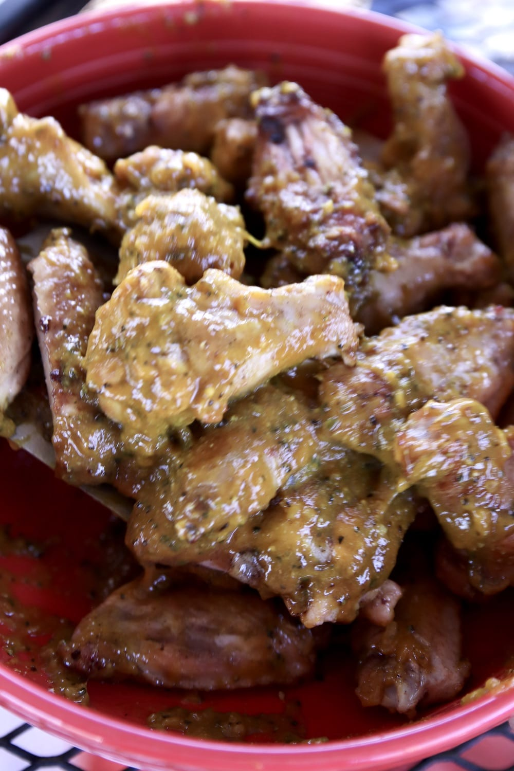 bowl of chicken wings with rosemary mustard sauce
