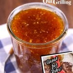 Apricot BBQ Sauce in jar with small photo overlay of brushing sauce on ribs