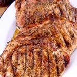 Platter of garlic & onion pork chops with text overlay