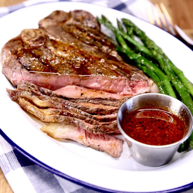 Whiskey Steak Sauce with a T Bone Steak and asparagus