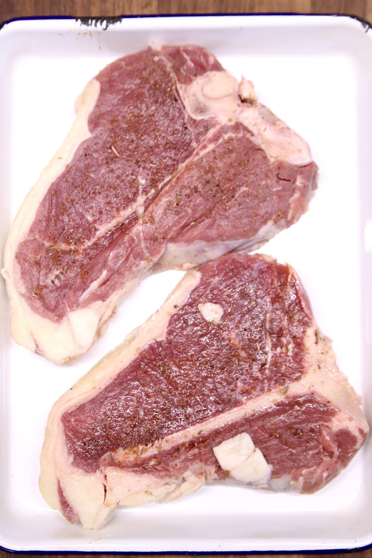2 T-Bone Steaks on a white pan