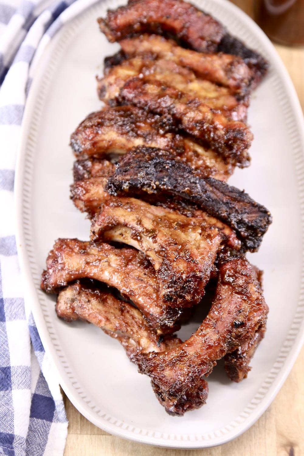 Barbecued Baby back ribs on a white oval platter