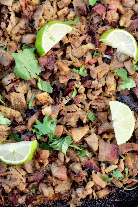 Smoked Pork Carnitas with lime slices and cilantro
