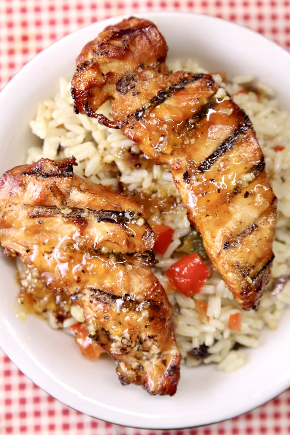 Grilled chicken tenders with rice pilaf in a bowl