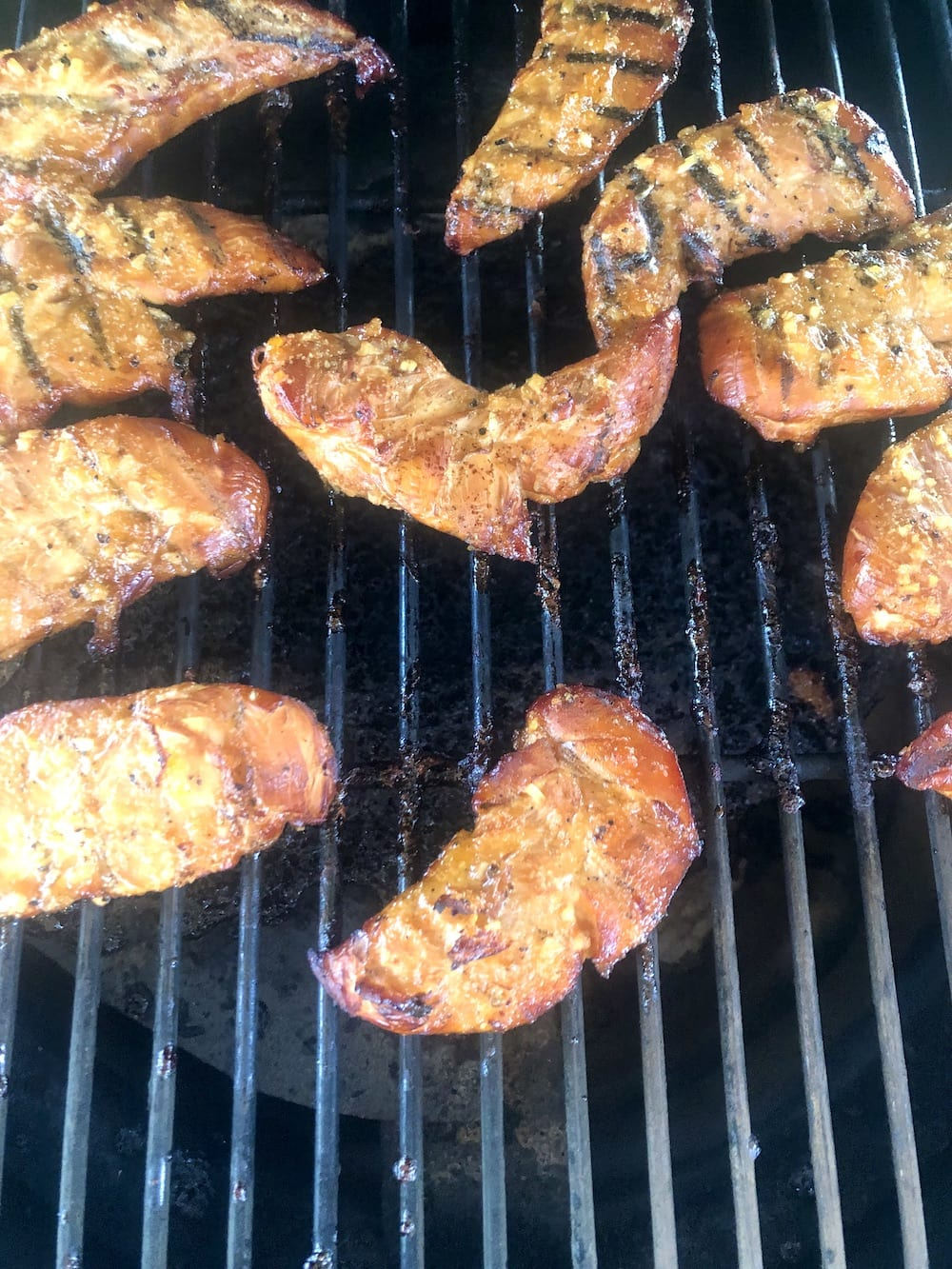 Apricot chicken tenders on a grill