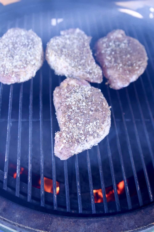 4 pork chops on a grill