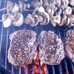 Bourbon Garlic Butter Tenderloin steaks on a grill with mushroom skewers