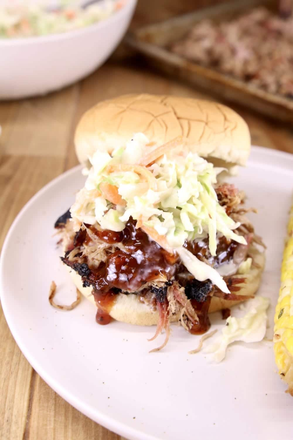 pulled pork bbq sandwich with slaw on a plate