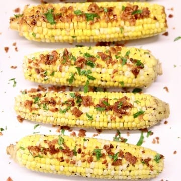 Corn on the cob with bacon crumbles