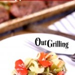 Grilled Filet Mignon on a plate with peppers and onions - text overlay