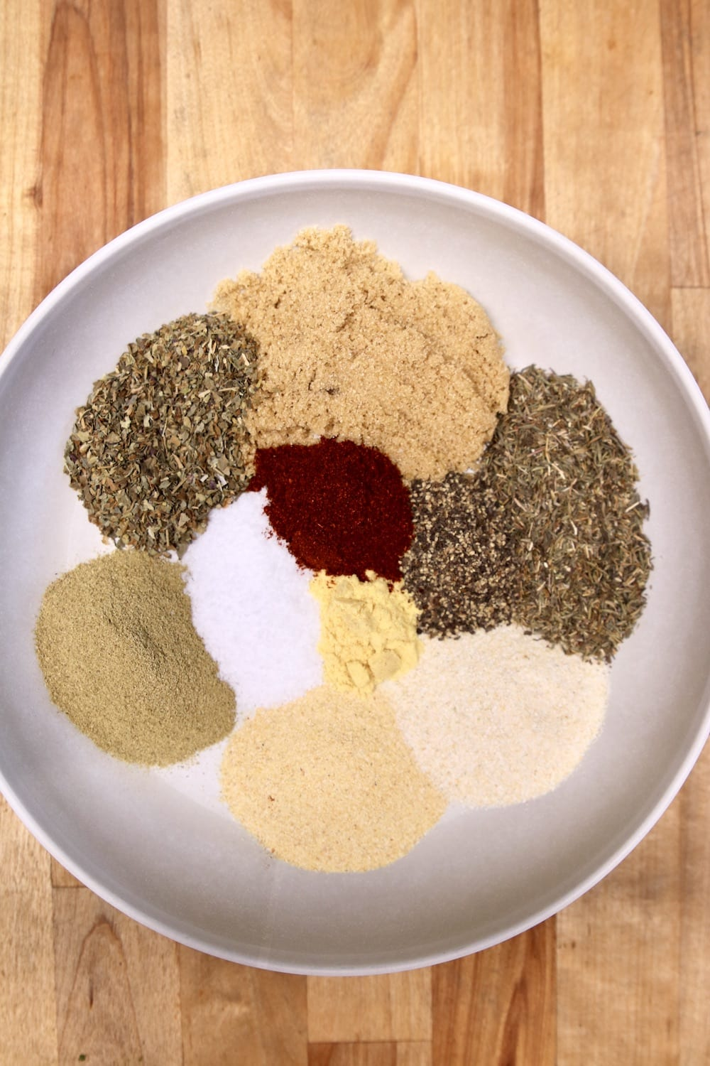 bowl of spices for garlic and herb rub - not combined