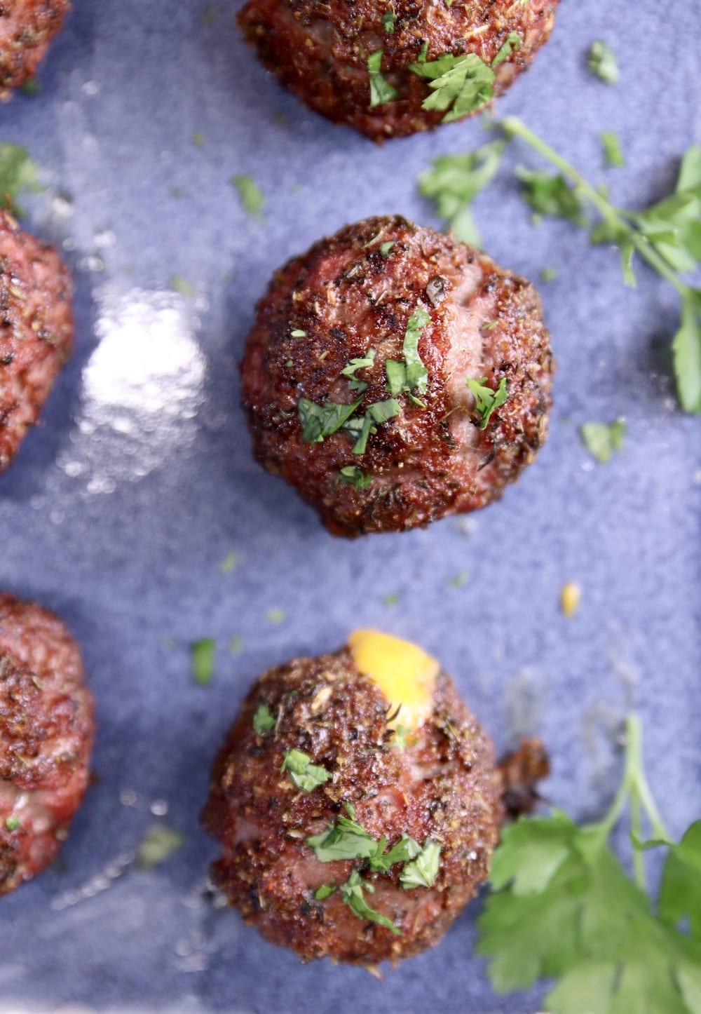 Grilled Meatballs on a blue platter