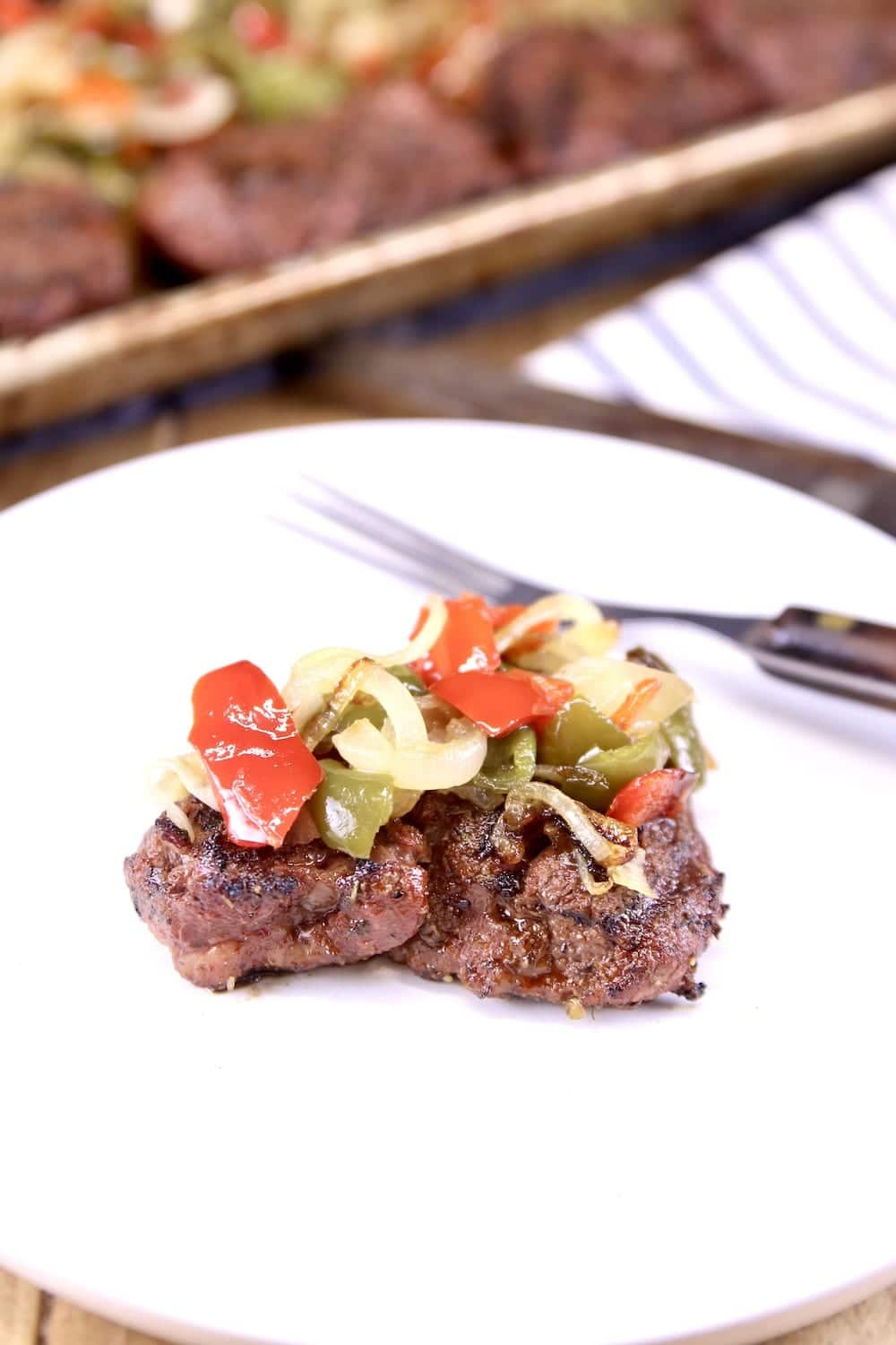 Grilled Filet Mignon Steak topped with peppers and onions
