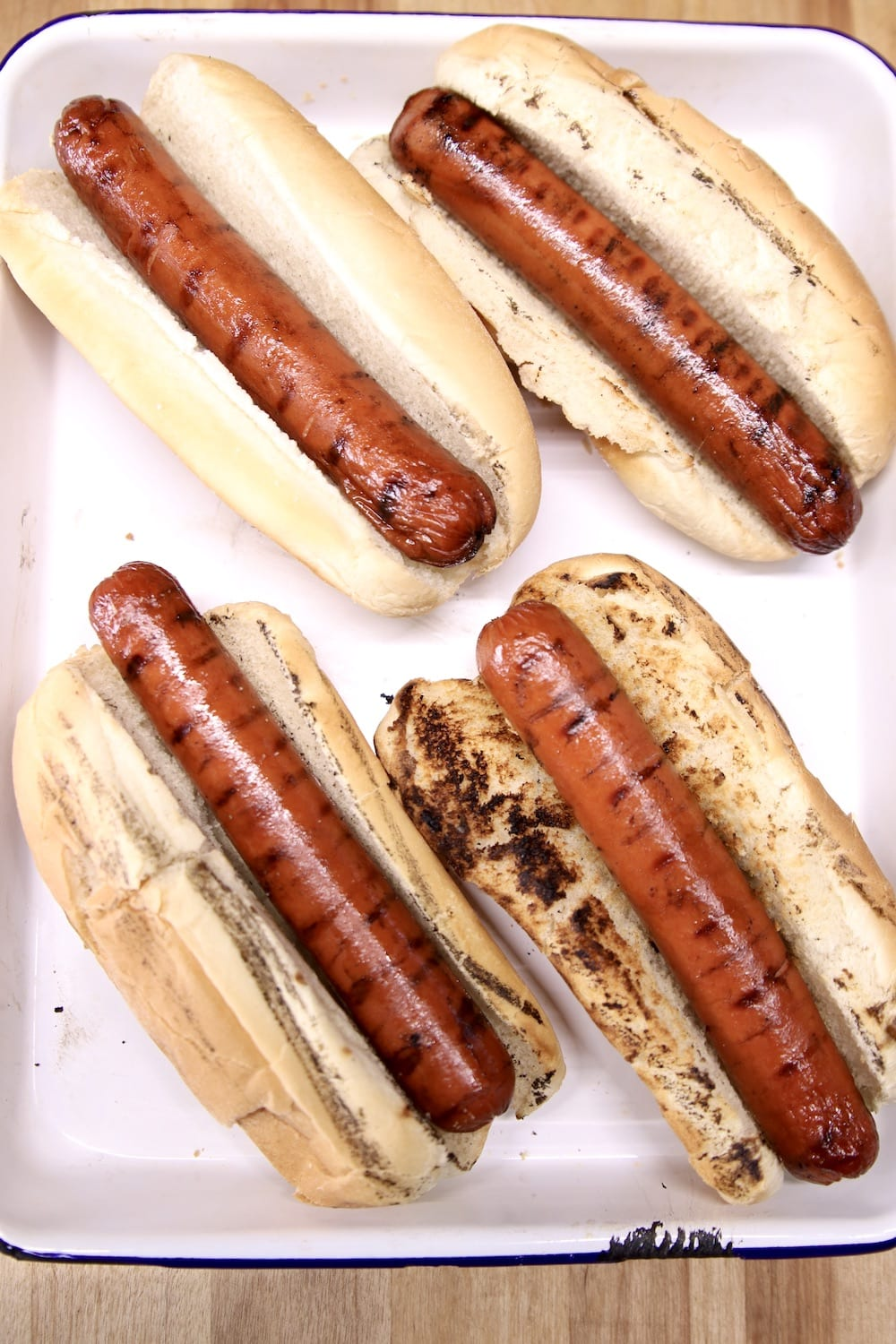 grilled hot dogs in toasted buns