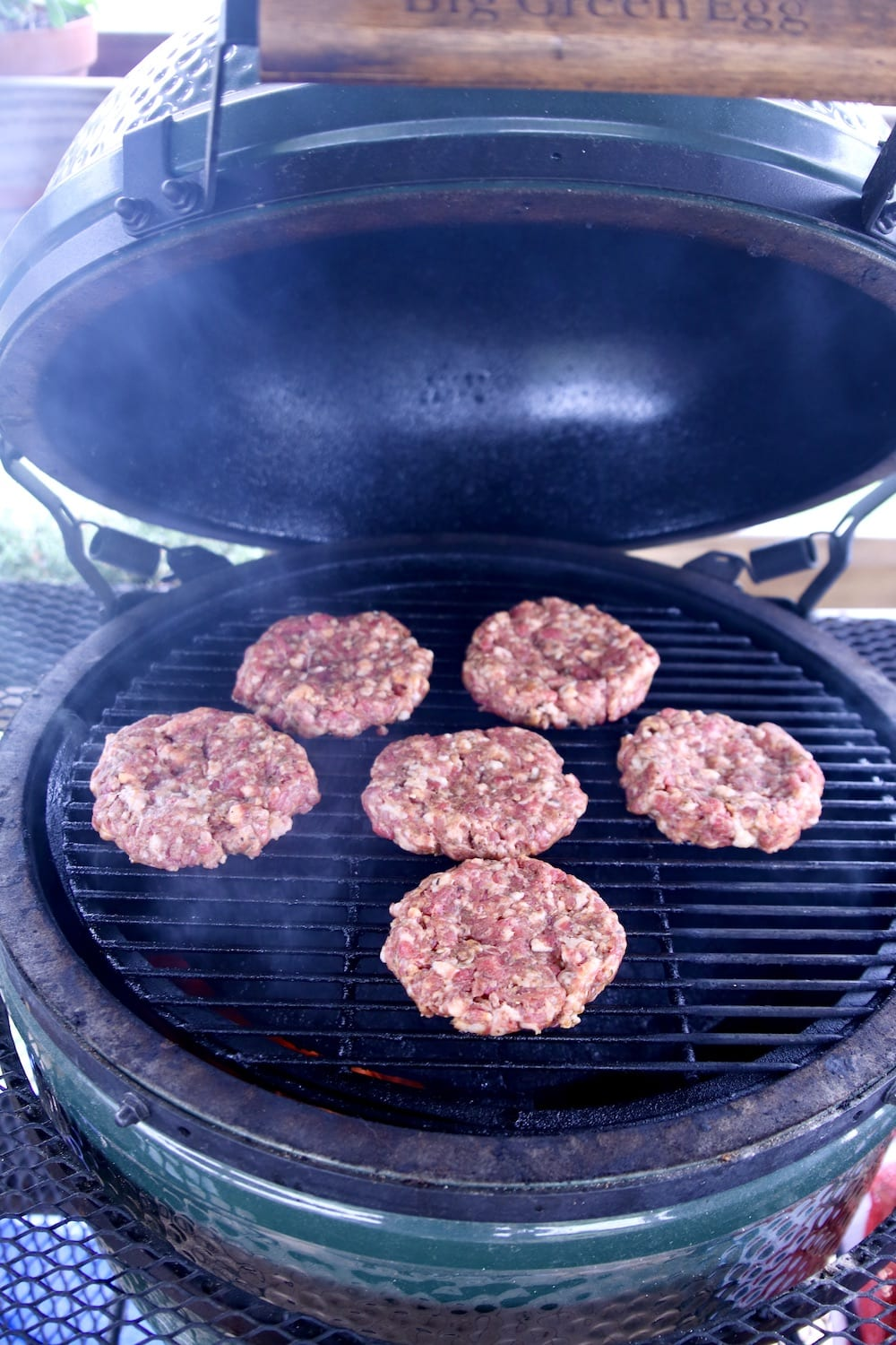 6 burger patties on a big green egg grill