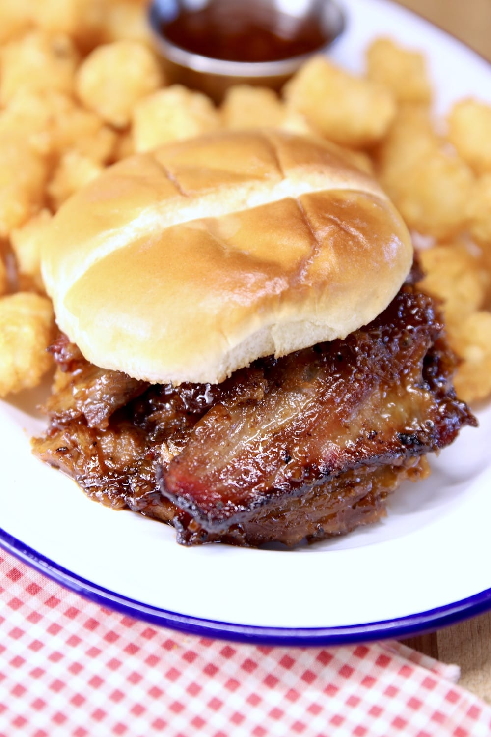 BBQ Brisket Sandwich on a plate with tater tots