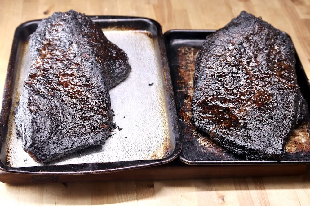 2 smoked briskets on sheet pans, unsliced