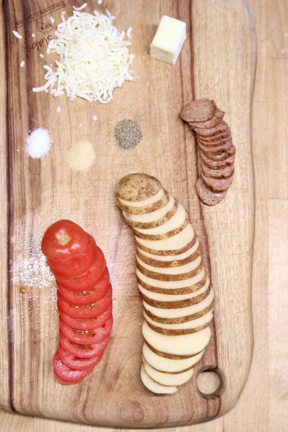 ingredients on a cutting board for smoked sausage potato rounds