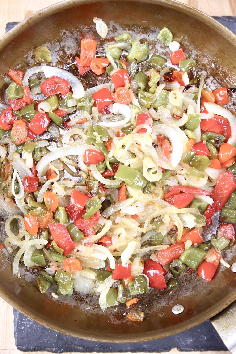 skillet of cooked onions and bell peppers