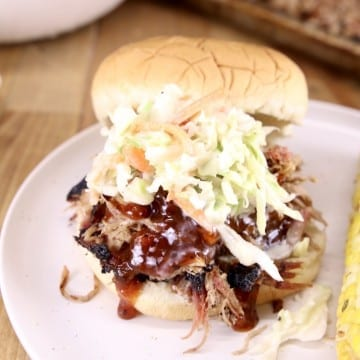 pulled pork bbq sandwich with coleslaw on a bun