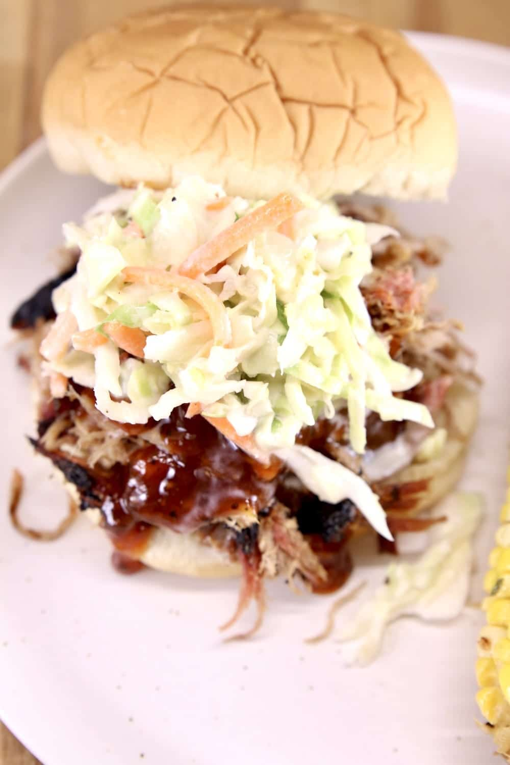 Pulled pork sandwich with bbq sauce and slaw