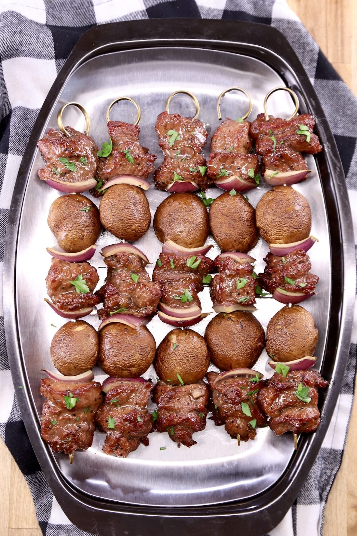 Platter of steak and mushroom kabobs