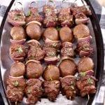steak and mushroom kabobs on a platter