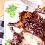 BBQ Spatchcock Chicken on a serving platter -text overlay