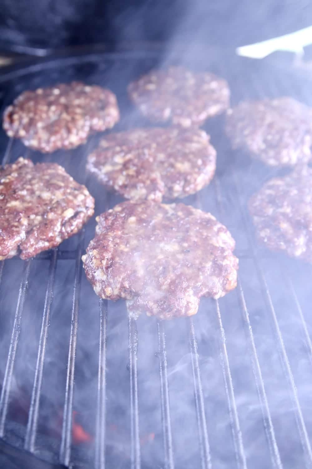 smoky grill with burgers