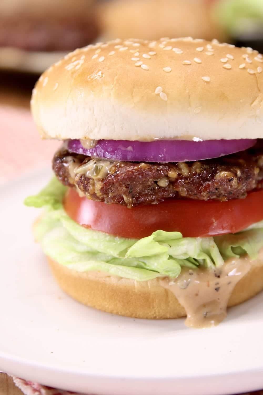 closeup of grilled burger on a bun