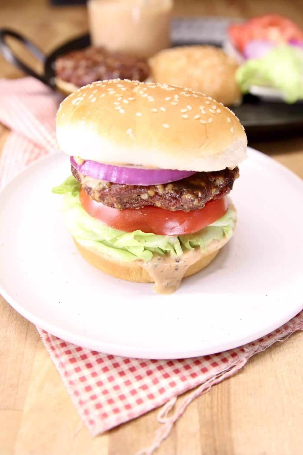 grilled burger on a bun - plated