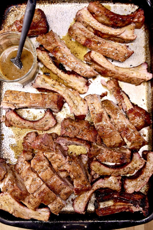 sheet pan of sliced ribs and orange pineapple glaze