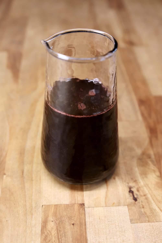 Pomegranate Steak Sauce in a glass jar