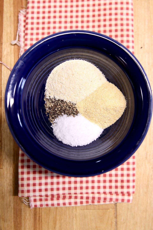 salt, pepper, onion and garlic in a bowl