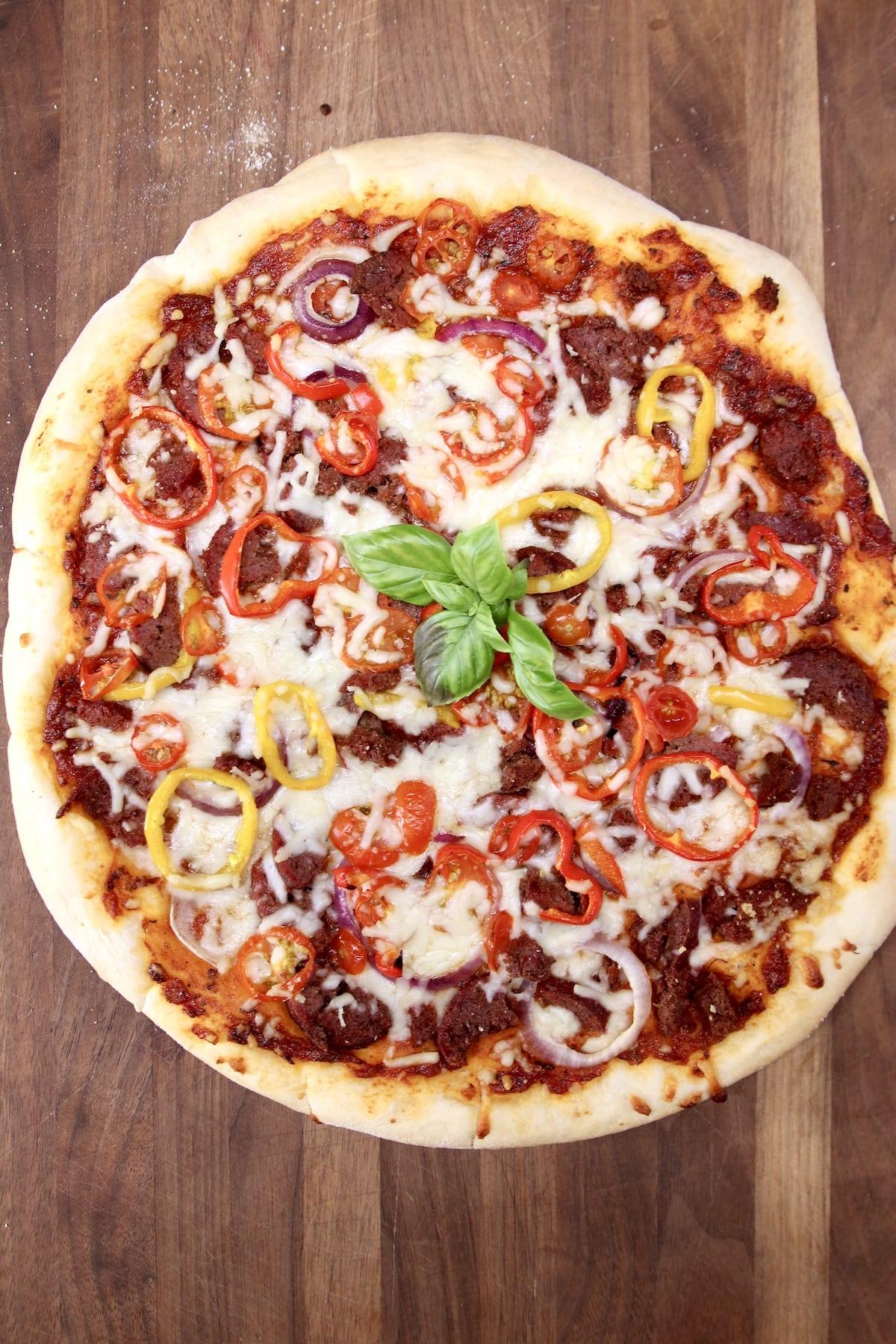 Grilled Pizza on a walnut cutting board